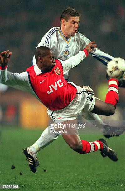 4th November 1998 UEFA Champions League Kiev Dynamo Kiev 3 v Arsenal 1 Arsenal's Luis Boa Morte goes flying as Dynamo Kiev's Oleg Luzhny challenges...