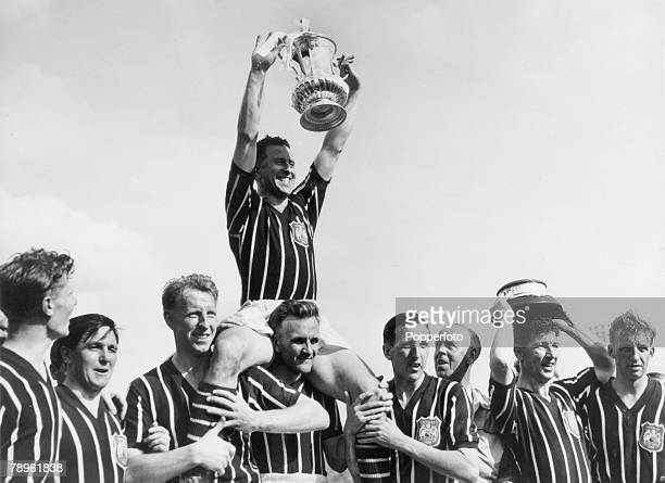 5th May 1956 FA Cup Final at Wembley Manchester City 3 v Birmingham City 1 Manchester City captain Roy Paul holds the FA Cup aloft whilst sitting on...