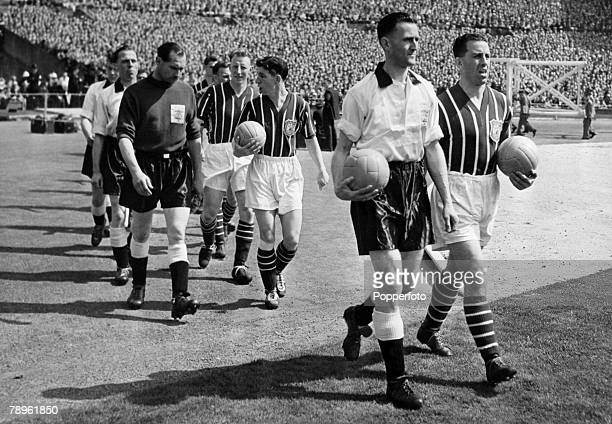 5th May 1956 FA Cup Final at Wembley Manchester City 3 v Birmingham City 1 Rival captains Len Boyd Birmingham City left and Roy Paul Manchester City...