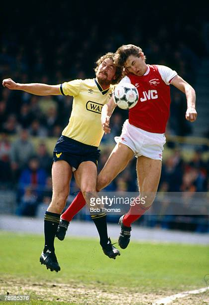5th May 1986 Division 1 Oxford United 3 v Arsenal 0 Arsenal's Tony Adams contests a high ball with Oxford United's Billy Hamilton left
