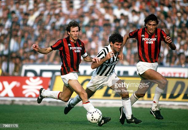 5th October 1986 Italian League Serie A Juventus 0 v AC Milan 0 Juventus striker Massimo Briaschi centre races for the ball with AC Milan's Franco...