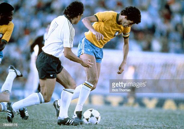 7th January 1981 Copa de OroMontevideo Brazil 4 v West Germany 1 Brazil's Socrates closely watched by West Germany's Felix Magath