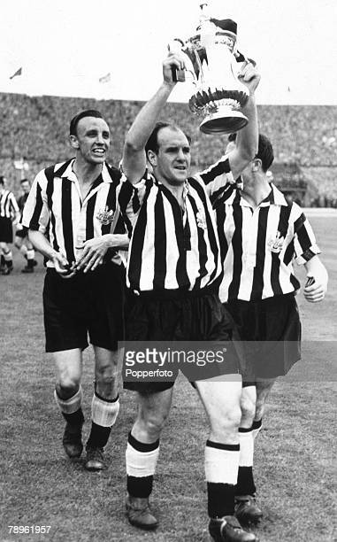7th May 1955 FA Cup Final at Wembley Newcastle United 3 v Manchester City 1 Newcastle United captain Jimmy Scoular holds aloft the FA Cup with...