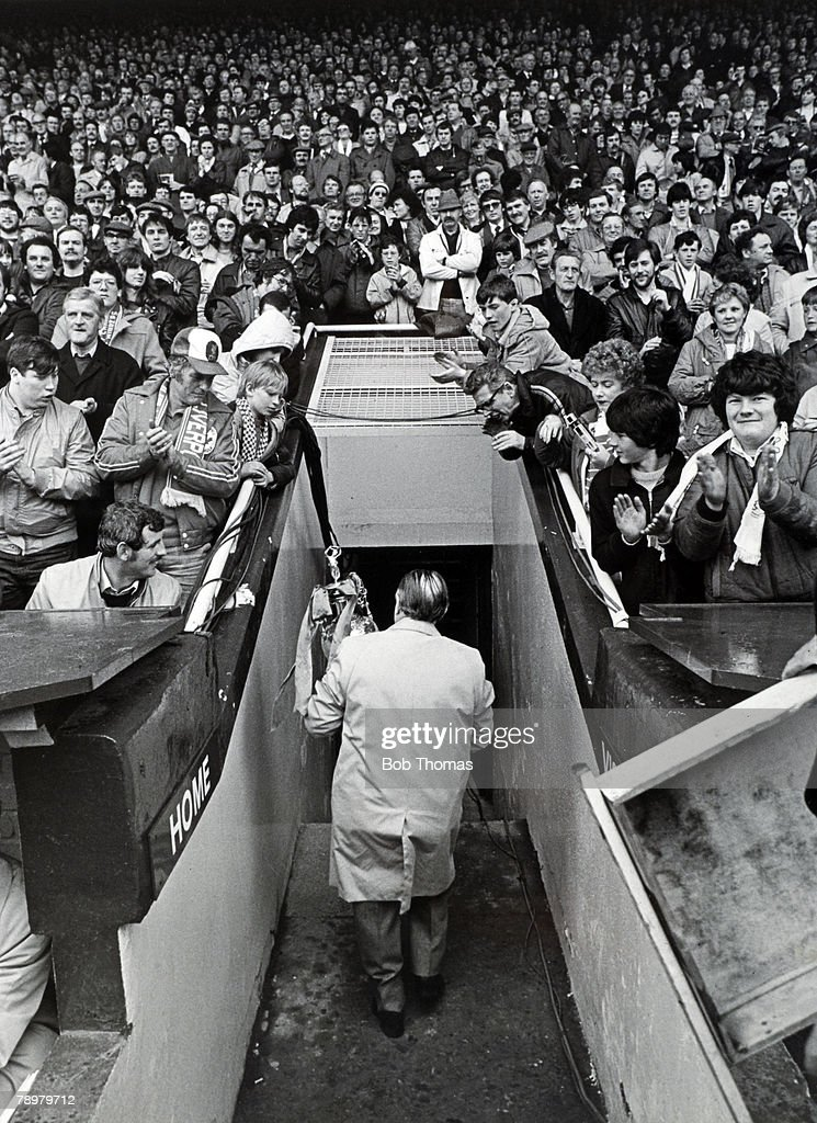 7th May 1983, Division 1, Liverpool 1 v Aston Villa 1, Bob Paisley walks down the tunnel at Anfield carrying the League Championship trophy, prior to his last home match as Manager of Liverpool