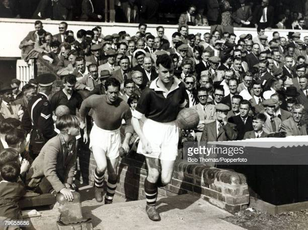 8th September 1956 Northampton Town 4 v Notts County 0 Northampton Town captain Maurice Marston leads out the team followed by goalkeeper Peter...