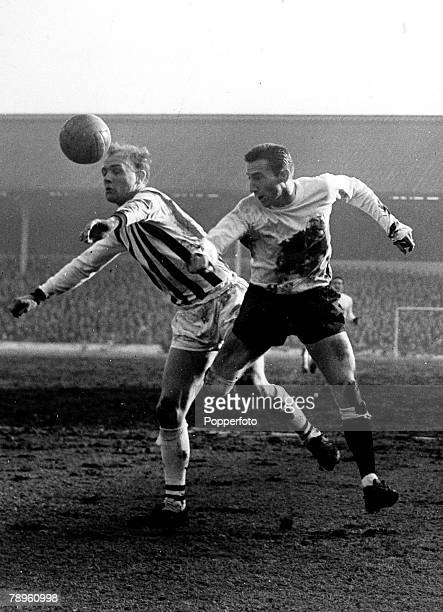 circa 1960 West Bromwich Albion defender Don Howe beats Tottenham Hotspur's Cliff Jones to the ball