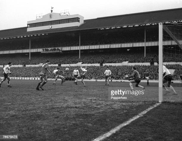 circa 1969 Division 1 Tottenham Hotpur v Manchester United at White Hart Lane Manchester United's George Best shoots for goal watched by the...