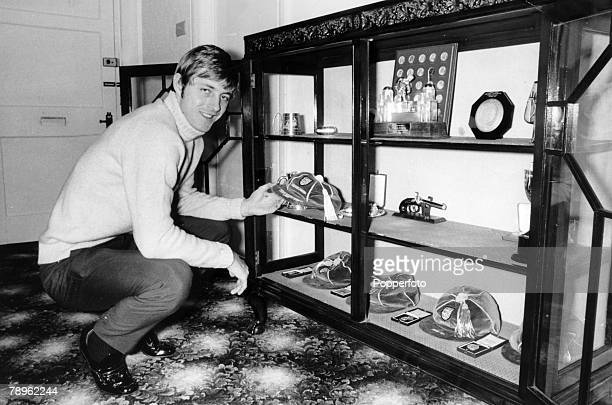 circa 1971 Leeds United and England striker Allan 'Sniffer' Clarke pictured at home as he takes a look in his trophy cabinet Allan Clarke played for...