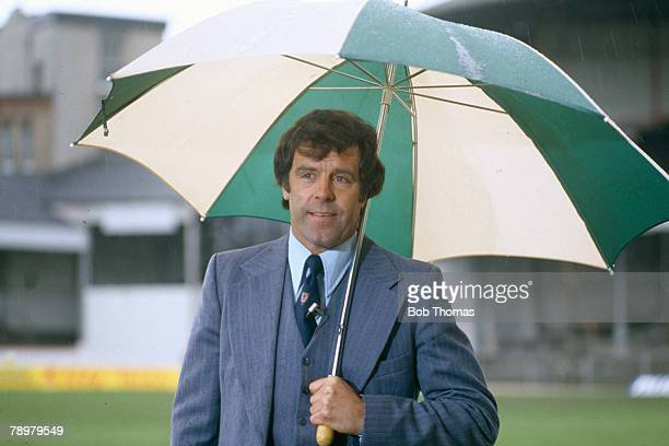 circa 1980's Mike England Wales Manager sheltering from the rain
