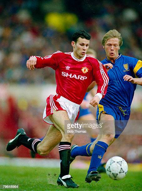 circa 1992 Manchester United's Ryan Giggs races away from Wimbledon's Warren Barton