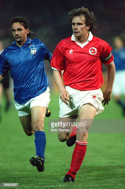circa 1993 International Match Switzerland v Italy Switzerland's Alain Geiger right races past Italy's Roberto Baggio