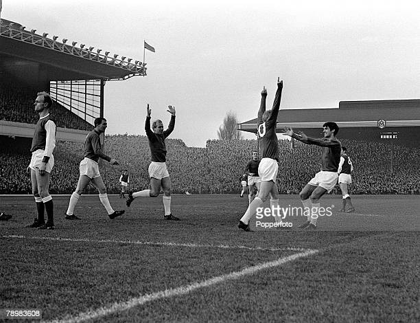 December 1964 Division 1 Arsenal v Manchester United at Highbury Manchester United's Denis Law celebrates his goal with George Best right and Bobby...