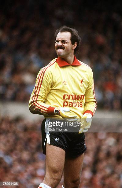 October 1985 Liverpool's Bruce Grobbelaar has fun with two coins fans had thrown at him in the game v Manchester United