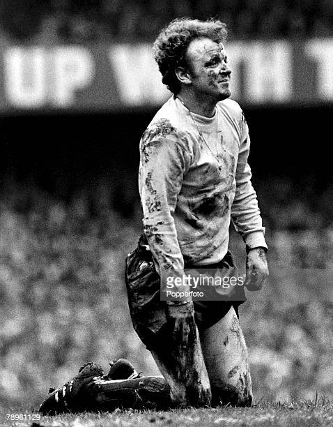 1st April 1972 Division 1 Derby County v Leeds United at the Baseball Ground Leeds United captain Billy Bremner is pictured on his knees covered in...