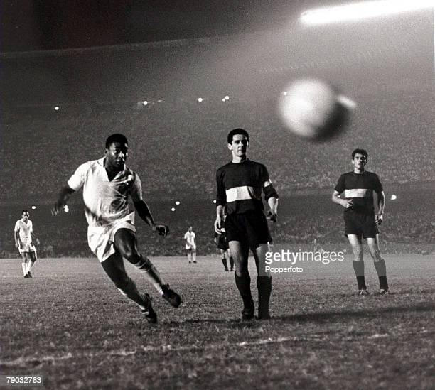 Sport Football South American Championship September 1963 Santos v Boca Juniors Pele of Santos watching the ball with Boca Juniors defenders Pele was...