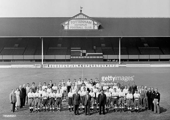 Sport Football White Hart Lane London England The Tottenham Hotspur ground staff managers trainers players etc line up together for a group photograph