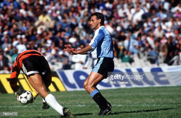 Sport Football World Cup Qualifier Montevideo 17th September 1989 Uruguay 2 v Bolivia 0 Uruguay's Antonio Alzamendi challenges Bolivia's goalkeeper...