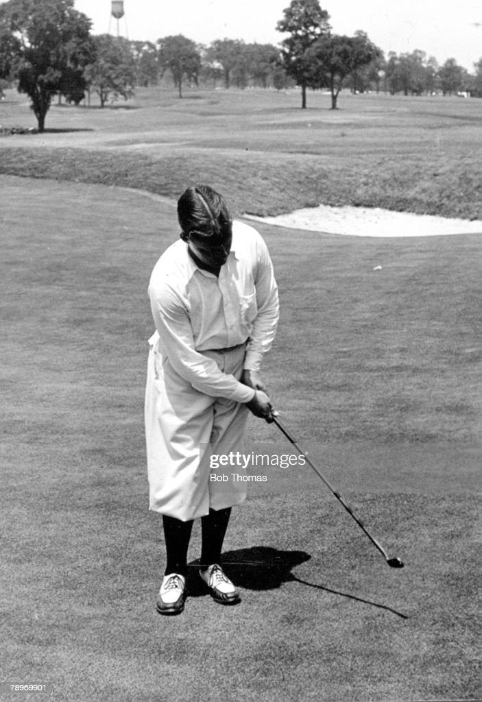 Sport Golf Circa 1930 Winged Foot Country Club Mamaroneck New York USA's Bobby Joneswinner of 3 British and 4 USOpens sinking a putt with his famous...
