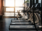 Sport gym interior with treadmill equipment in the morning
