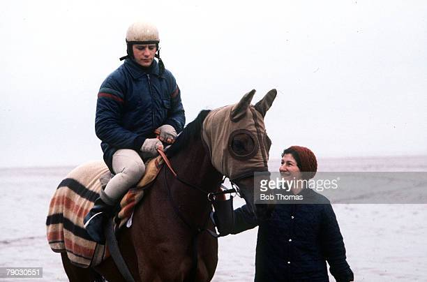Sport Horse Racing Circa 1980's The race horse Red Rum is pictured during a training run with Billy Beardswood and Beryl McCann