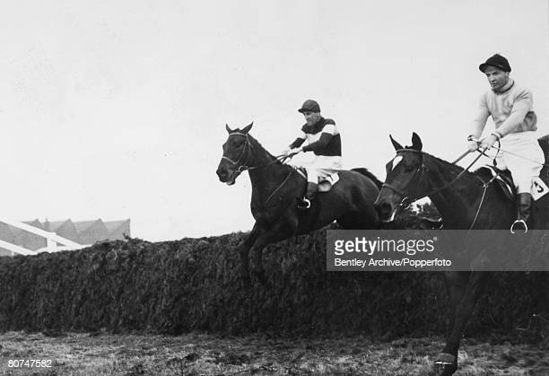26th March 1956 1956 Grand National at Aintree The Queen Mother's horse Devon Loch ridden by Dick Francis is pictured leading ESB ridden by Dave Dick...