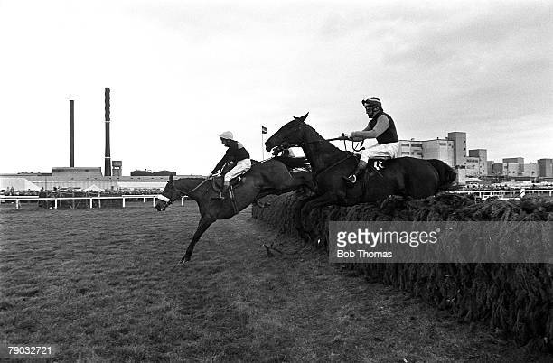 Sport Horse Racing The Grand National Aintree Liverpool England 3rd April 1976 The eventual runnerup Red Rum ridden by jockey Tommy Stack jumps a...