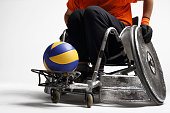 The man on the sports wheelchair with the ball