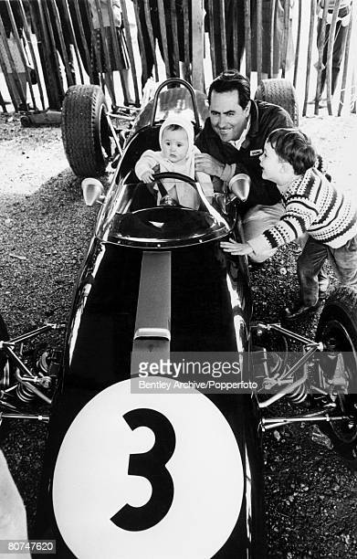 Sport Motor Racing Australian Racing driver Jack Brabham with his children six month old David and five year old Gary as they pose by a race car