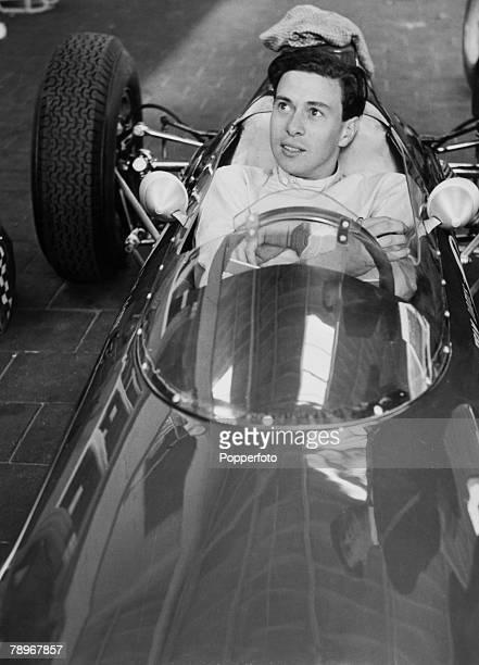 Sport Motor Racing Circa 1960's Portrait of Grand Prix driver Jim Clark sitting in his car