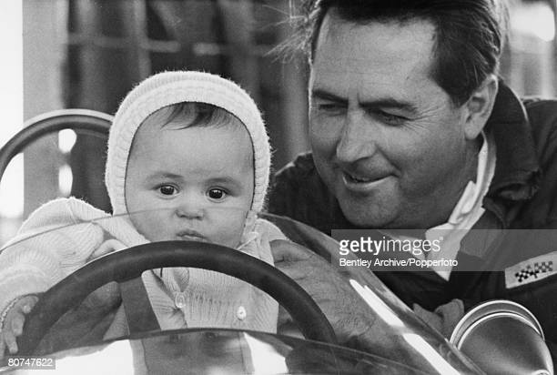Sport Motor Racing England April 1966 Australian Racing driver Jack Brabham with his six month old son David sitting in a racing car