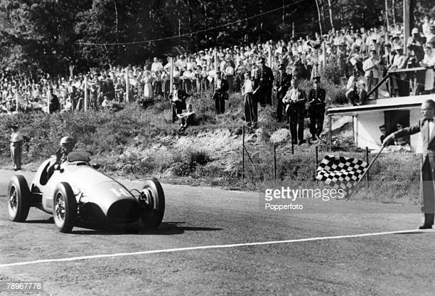 23rd June 1953 Belgium Grand Prix at Francorchamp Italy's Alberto Ascari in a Ferrari takes the chequered flag to win the race Alberto Ascari won two...