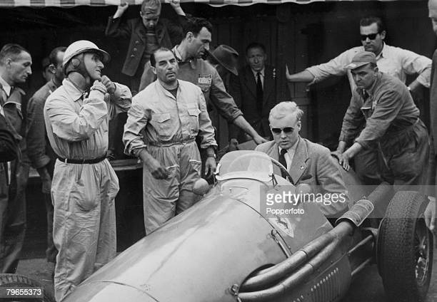 June 1954 Belgium Grand Prix at Francorchamps British racing driver Mike Hawthorn at the wheel of the Ferrari before going out on a practice lap Mike...