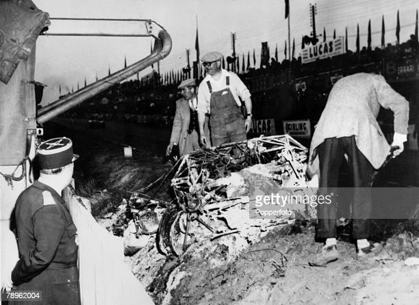 Sport Motor Racing Le Mans 24 Hour Race pic 11th June 1955 Men clearing debris after the crash when many spectators were killed after French driver...