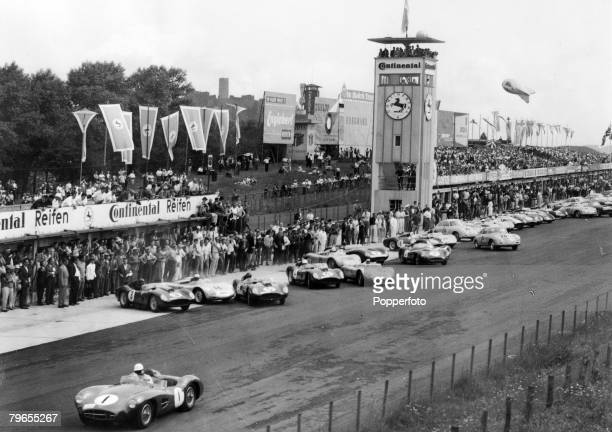 9th June 1959 Sports Car Race at Nuerburgring British driver Stirling Moss gets a flying start in his Aston Martin as he leaves the other drivers...