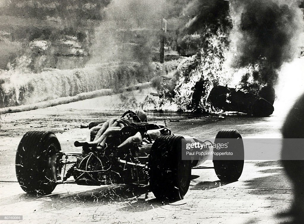 9th May 1967, Italy's Lorenzo Bandini in a Ferrari crashes after losing control at the chicane and the car ignites the straw bales causing a fireball with Bandini trapped in the flaming wreck, Another car approaching tries to pass the fireball, Lorenzo Bandini (1935-1967) had his best moment as a Grand Prix driver when he won the 1964 Austrian Grand Prix, but tragedy struck in 1967 when he was killed after an horrific crash at the Monaco Grand Prix when his Ferrari crashed and was engulfed in flames, He survived the crash but had severe burns, also the overturned car had crushed his chest and he succumbed to his injuries and died 3 days later