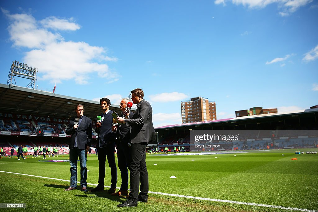 Sport pundits broadcast from pitchside prior to kickoff during the Barclays Premier League match between West Ham United and Tottenham Hotspur at...