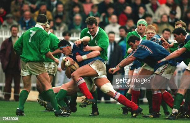15th January 1994 Five Nations Championship France 35 v Ireland 15 France's Abdelatif Benazzi grabbed by Ireland's Michael Galwey