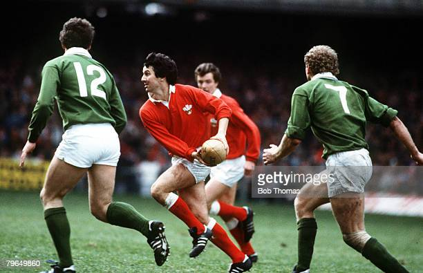 1985 5 Nations Championship in Cardiff Wales 9 v Ireland 21 Wales's stand off Gareth Davies about to pass watched by Ireland's Kiernan 12 and Carr