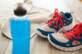 Sport shoes with energy drink and towel