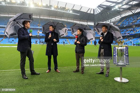 Sport television presenter Jake Humphrey stands with pundits Steve McManaman Michael Owen and Robbie Savage alongside the Premier League trophy prior...