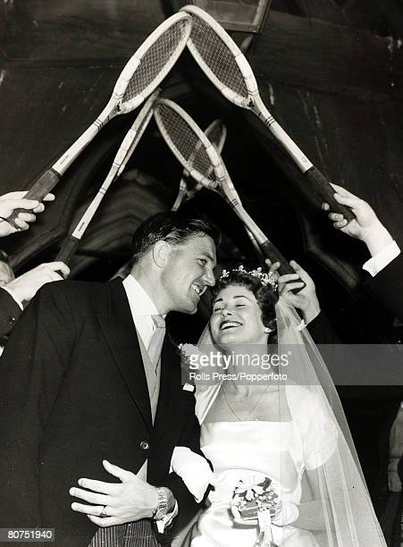 7th July 1958 Britain's No 2 tennis player Roger Becker marries Shirley Malkin at Croydon Surrey leaving the church under an arch of tennis racquets