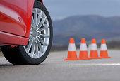 aluminium sport wheel and cones, Wheel on a red sport car