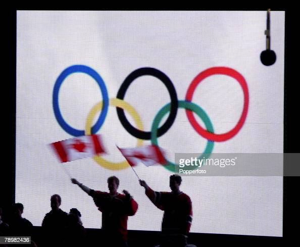 Sport Winter Olympic Games Salt Lake City Utah USA 24th February 2002 Ice Hockey Final Canada 5 v USA 1 Canadian fans wave flags in front of a TV...