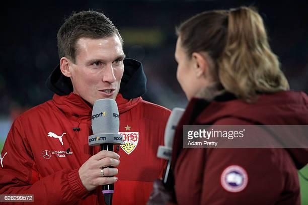 Sport1 TV host Laura Wontorra talks to head coach Hannes Wolf of Stuttgart prior to the Second Bundesliga match between VfB Stuttgart and 1 FC...