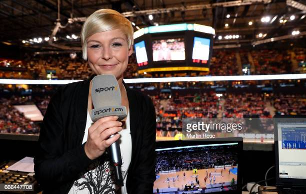 Sport1 tv presenter Anett Sattler looks on before the Rewe Final Four final match between SG FlensburgHandewitt and Thw Kiel at Barclaycard Arena on...