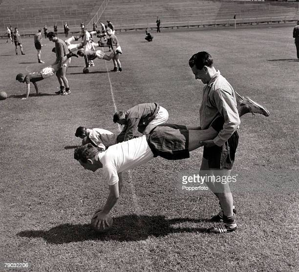 Sport/Football 1958 World Cup Finals in Sweden June 1958 England players Johnny Haynes and Bobby Robson do 'wheelbarrow' training in Gothenburg