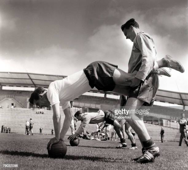 Sport/Football 1958 World Cup Finals Sweden June 1958 England pair Johnny Haynes and Bobby Robson doing 'wheelbarrow' training in Gothenburg