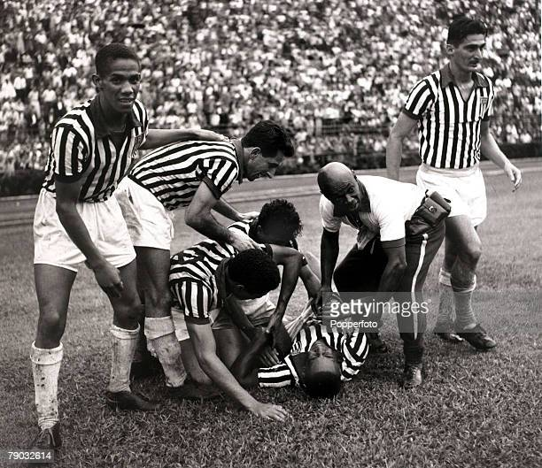 Sport/Football in South America circa 1960 Selection Sao Paulo v Selection Pernambuco Sao Paulo and Brazil's Pele receiving treatment as his...
