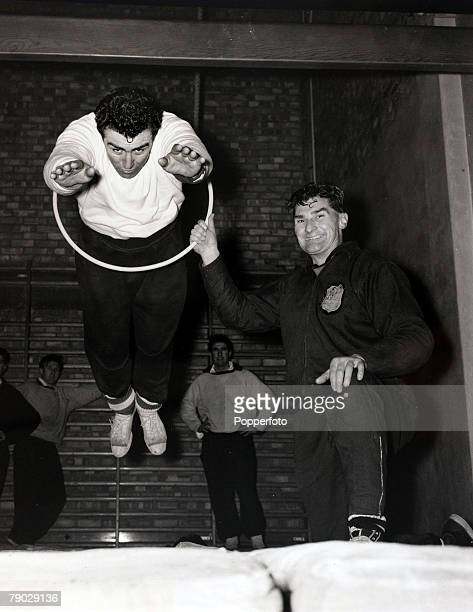 Sport/Football London England 2nd January 1963 Tottenham Hotspur training Tottenham Hotspur's Bobby Smith is 'put through the hoop' at White Hart...