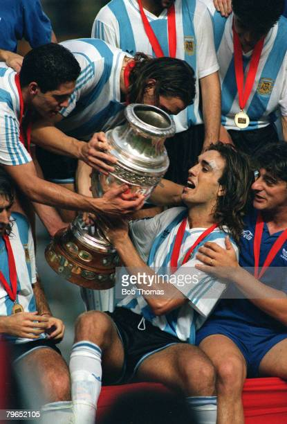 1993 Copa America Tournament Gabriel Batistuta of Argentina centre seated with the champions trophy and celebrating teammates